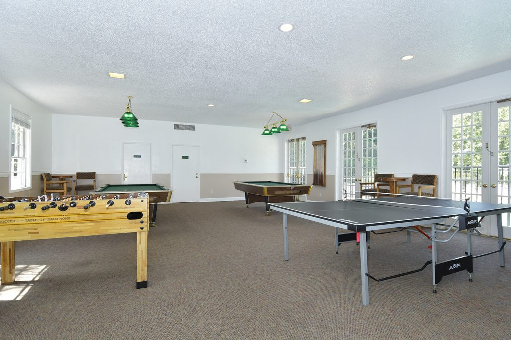 Game room with Foosball, ping pong and two pool tables.