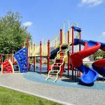 Playground area with slides, swings, jungle gym.
