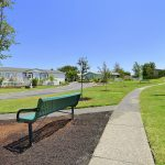Clean paved walking paths through the community. Benches along the way.