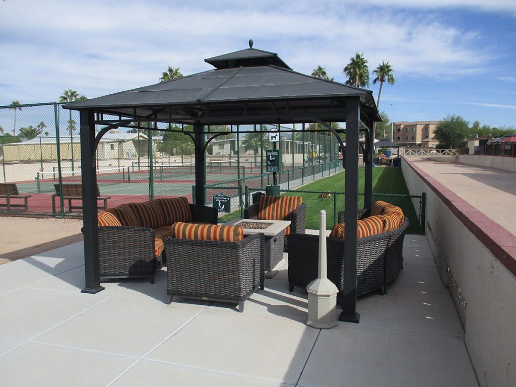 Big Gazebo with plenty of seating and outdoor fire pit located by tennis courts and fenced in dog park. Homes for sale at Holiday Palms. Call 866-782-5781