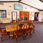 The clubhouse has an organ for playing and announcements on a corkboard of community events. A wood table with chairs is available. A big screen TV is mounted above the fireplace