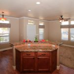 Holiday Palms, a 55 plus manufactured home community offers spacious open floor plans with beautiful kitchens. some offer a kitchen island, high ceilings, living area with ceiling fan