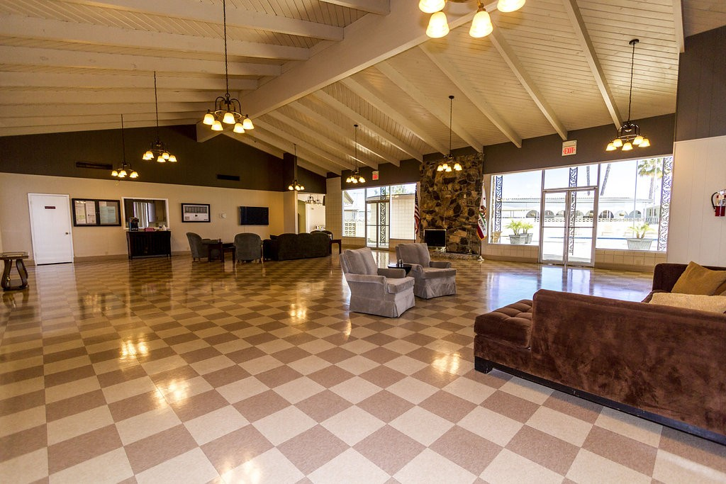 Large community hall provides an open space for residents to enjoy activities and lounge with fellow residents.