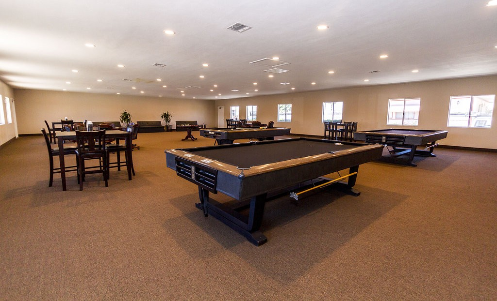 Spacious and updated billiards room provides an area to enjoy table card games or a few games of pool.