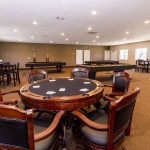Modern black and brown poker table and chairs with room for six players. Comfortable chairs allow for long enjoyable games with friends and family.