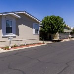 Beautiful, well-kept manufactured homes line the wide, clean streets of the community.