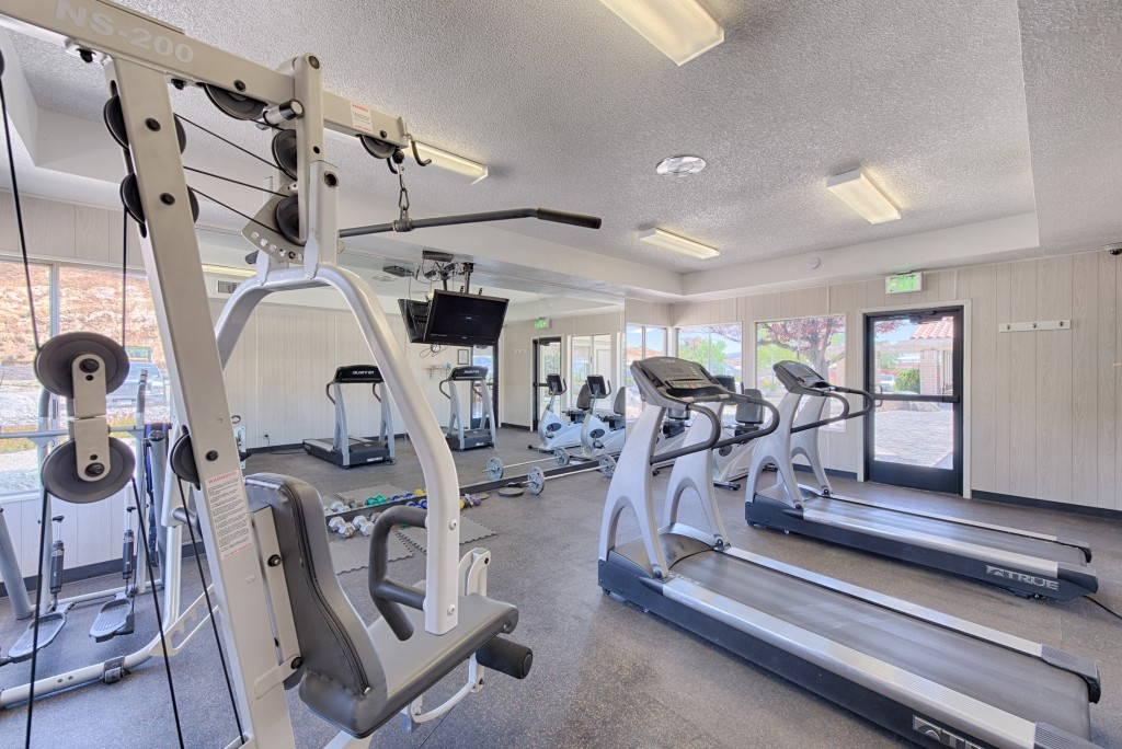 Well equipped fitness center with treadmills, weight machines and free weights. Large mirror from floor to ceiling to utilize while working out.
