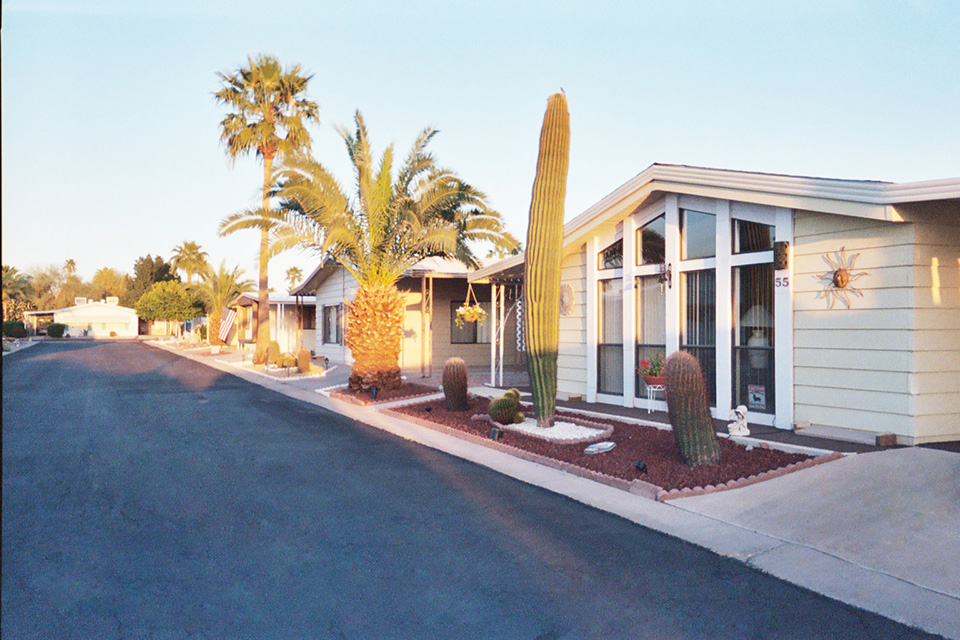 Holiday Palms, a 55 plus manufactured home community, offers wide, open, clean, quiet streets through out the neighborhood and beautiful homes decorated with Palm Trees, Cactus and desert scenery