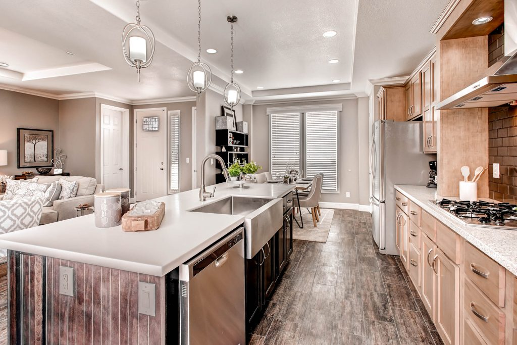 Brand new kitchen with beautiful hardwood floors. Recessed lighting and custom lighting over the long kitchen island. Slate countertop on island with farm sink. Stainless steel kitchen appliances with the dishwasher as part of the island. Light copper cabinets.