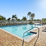 Fountainview Estates, an active 55 plus community in Tampa Florida with clean pool and lounge chairs surround pool area.