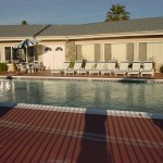 One of two outdoor pools located right outside one of the community centers. Full size pool surrounded by lounge chairs and shaded tables with additional seating. Open space for residents to host parties with family and friends.