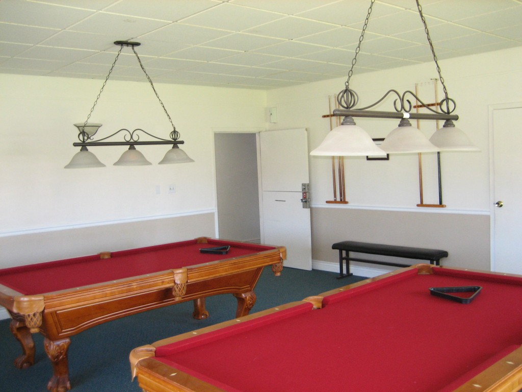 Community billiards room with two billiard tables for use by the residents to enjoy.