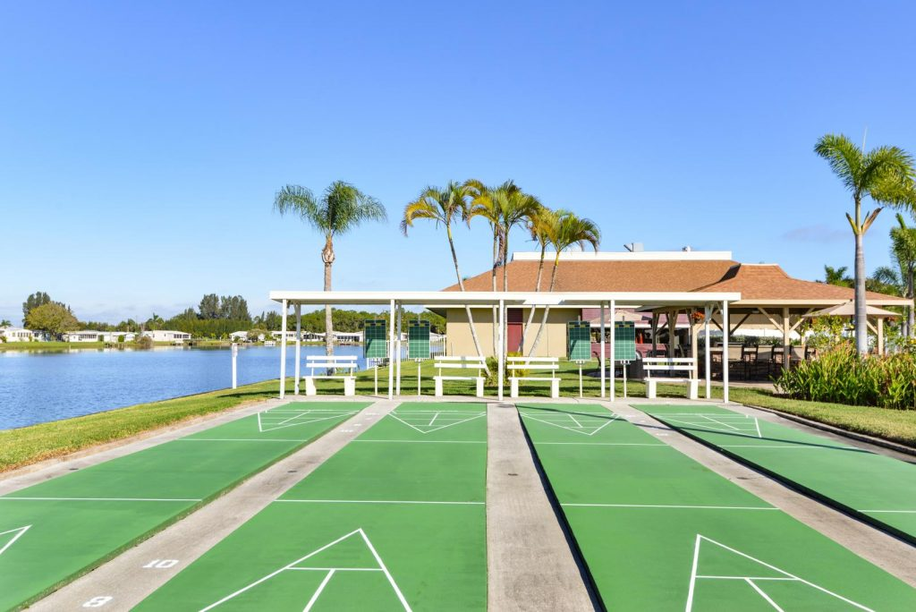 Four shuffleboard courts with covered seating. Sits next to lake.