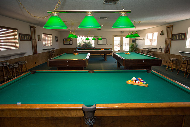 Large billiards room with four pool tables