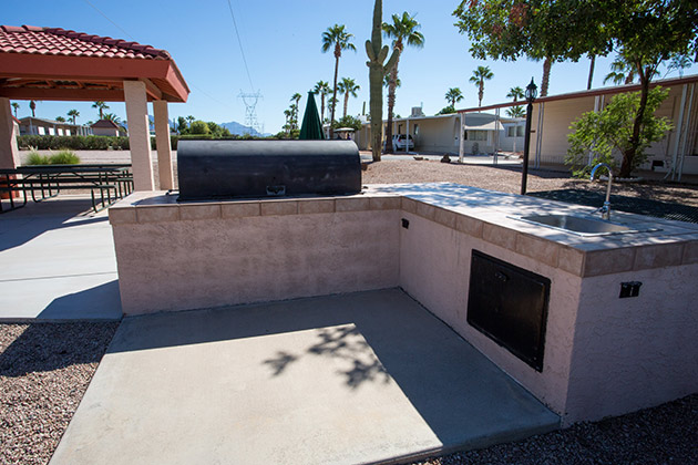 Large built in barbecue area with patio area and sink