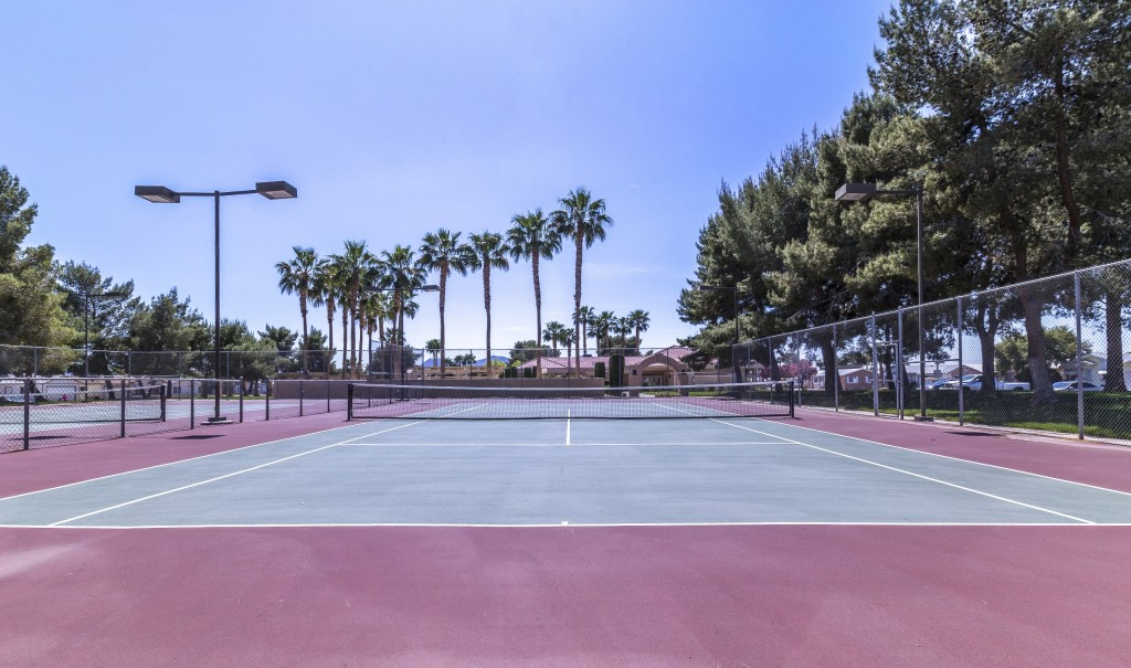Two tennis courts. Installed lights for nighttime play.
