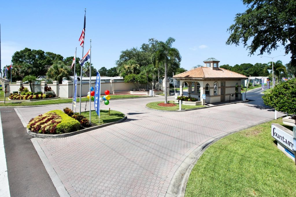 Very clean gated entrance to Fountainview Estates. Security booth for in and out of community. Well kept landscape with American flag flying on flag pole. Lots of plush greenery.
