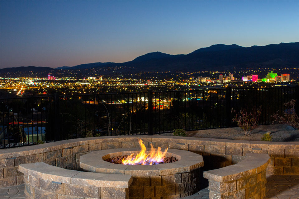 Warm up at sunset at an outdoor firepit and enjoy the twinkling lights and skyline of Downtown Reno. Beautiful mountains in the background.