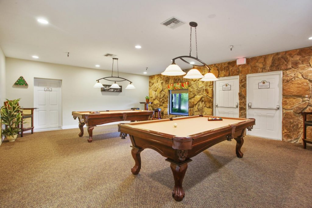 Game room with 2 pool tables.
