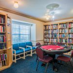 In the library are many books to entertain and also a card table to play an assortment of games.