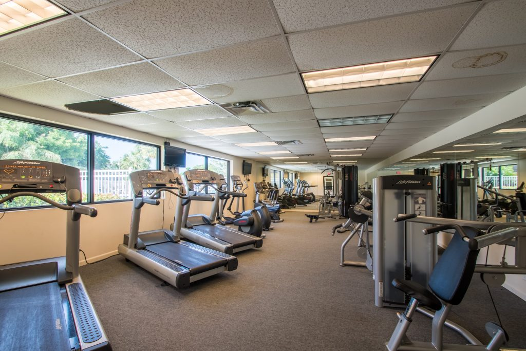 Fitness center has treadmills, stationary bikes and weight machines.