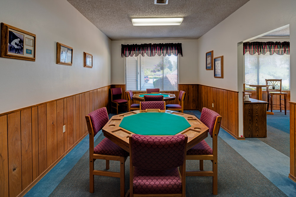Royal Villas, a 55 plus manufactured home community, with card room. Two card tables with chairs.
