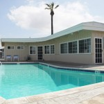 Welcoming community clubhouse and outdoor pool available for residents to reserve for parties and family events.