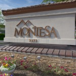 Large Montesa sign at entrance to community. Flowers decorate all around