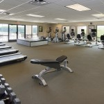Large fitness room with free weights, treadmills, bikes, bench and stairmasters. Workout mat. Watercooler.