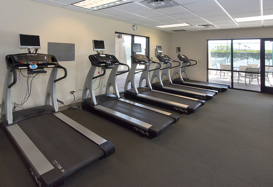 Fitness room with 5 treadmills that have own TV.