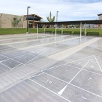 Five outdoor shuffleboard courts with covered seating to watch
