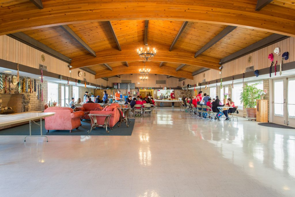 Open concept community center with high vaulted ceilings provides a space for residents to enjoy activities with one another.