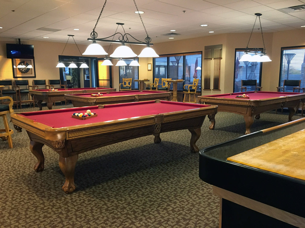 Montesa at Gold Canyon, an upscale 55 plus community, with a billiards room. 4 pool tables, dart board. TV mounted to the ceiling and high chairs and tables to use