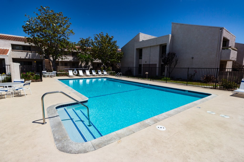 Welcoming outdoor pool enclosed by gates, within the center of the community.