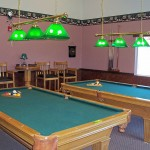 King Village, an all age manufactured home community has billiards room with two pool tables and seating.