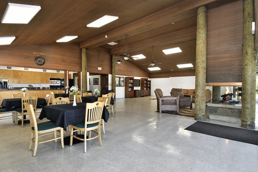 Large clubhouse with beautiful fireplace, ample seating, and equipped with full kitchen.