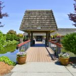 beautiful bridge over pound with covered gazebo. Leads to the main office and clubhouse.