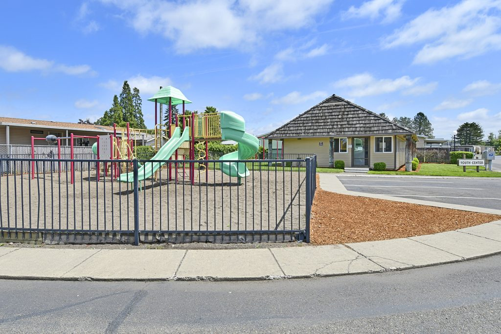 Community playground enclosed by gates for residents to enjoy. Adjacent to the youth center.