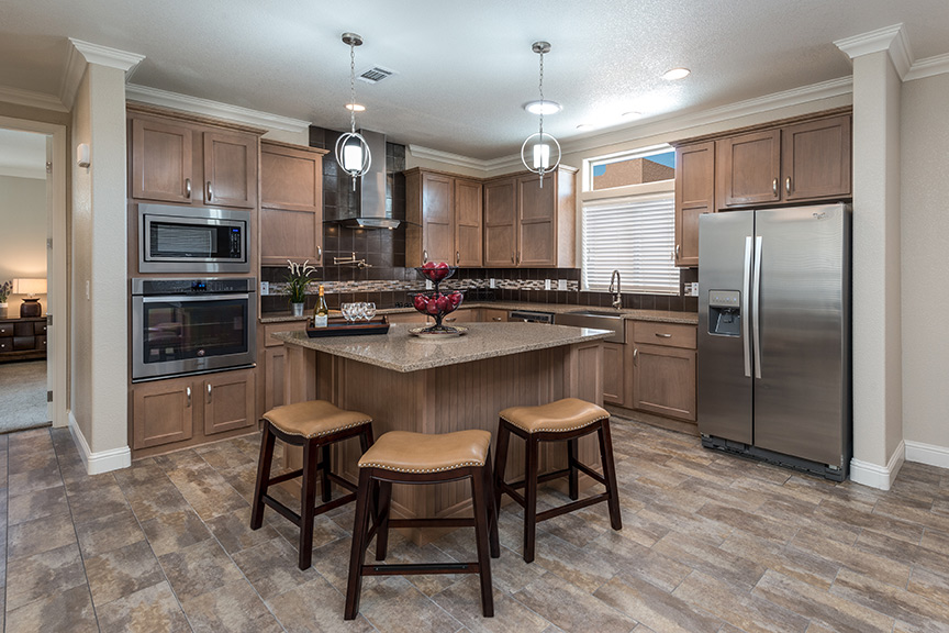 Beautiful, spacious, open kitchen with stainless steel appliances and kitchen island. Wood flooring.
