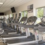 Large, updated fitness center with a variety of workout equipment which will be coming soon to Naples Estates as one of the many amenities.