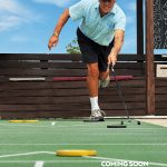 Older gentleman playing on a tournament level shuffle board court that will be one the many amenities being added to the community.