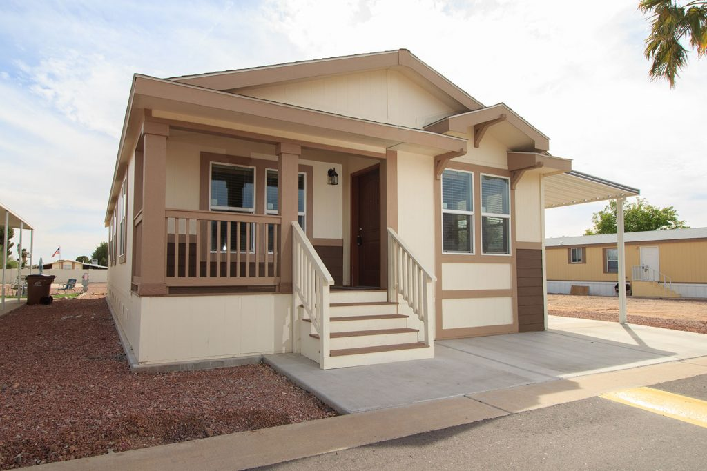 A brand, home for sale at Sierra Estates with small steps leading up to the porch and front door.