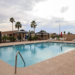 Sierra Estates, an all age community in Mesa Arizona has a community pool with cabanas and lounge chairs around the pool