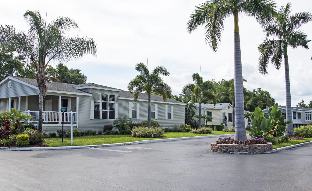 Beautiful manufactured homes are nicely landscaped with green grass, palm trees and small trimmed shrubs. Clean paved streets.