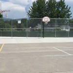 Medford Estates, an all age manufactured home community with outdoor basketball court.