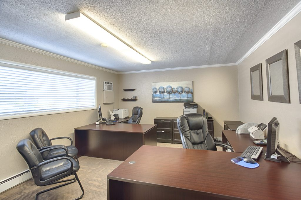 Front office equipped with updated furniture and technology. Neutral colors of brown, beige, and black throughout.