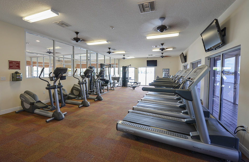 The fitness room has TVs mounted to wall for viewing while working out. There's treadmills and elliptical machines.