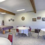 Community center equipped with billiard tables, multiple seating for community activities.