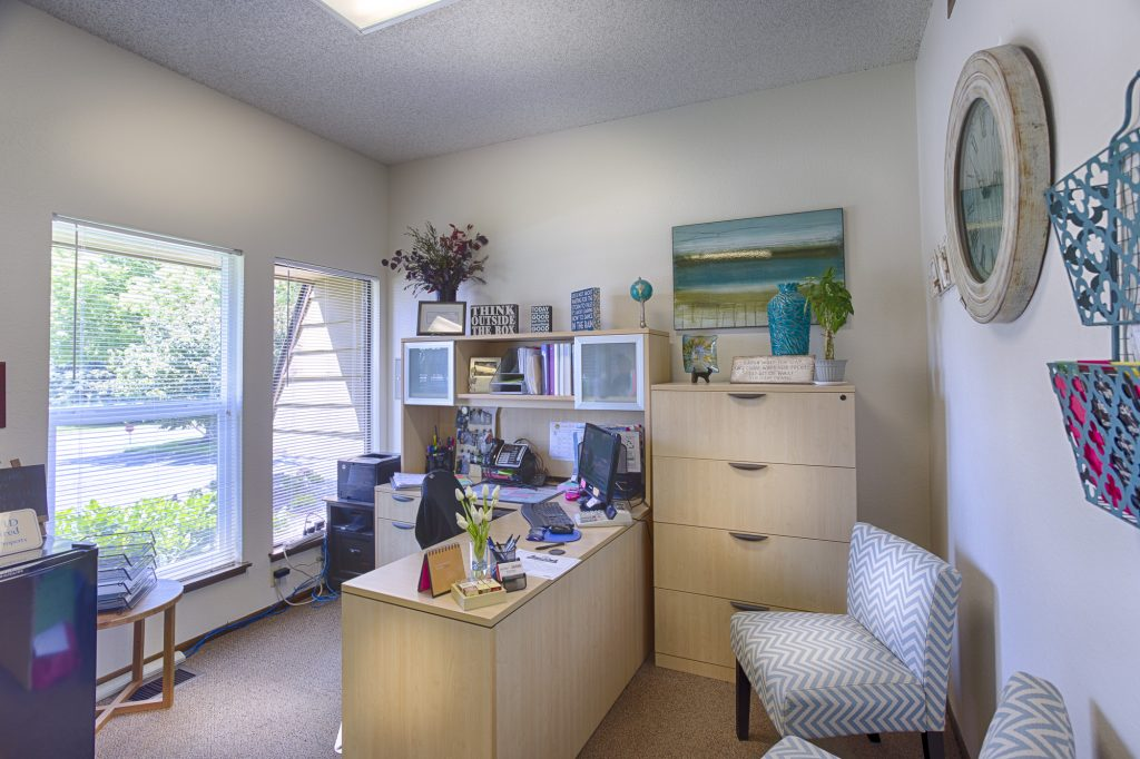 Front office full of natural light and light neutral colors throughout.