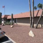 San Estrella office with flag pole and American flag at entrance.